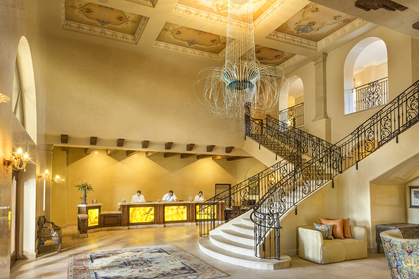 The resorts two story lobby with a center staircase and large ch