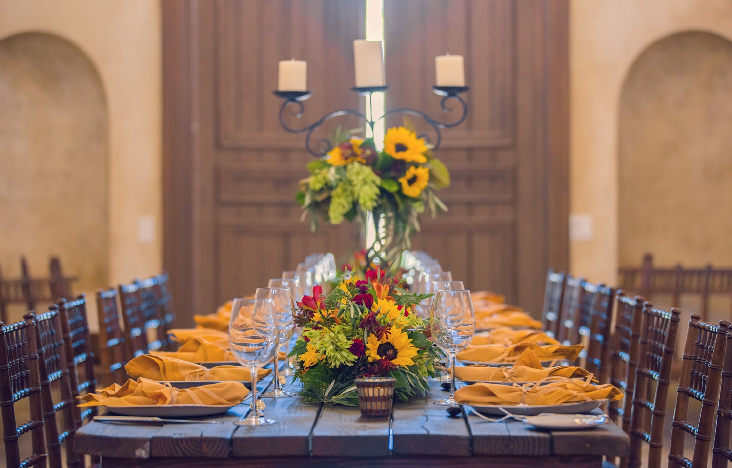 Private dining room area with sunflower center pieces at Allegre