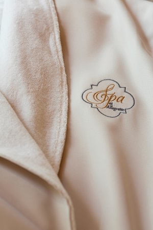Spa at Allegretto Vineyard Resort Paso Robles logo on a robe
