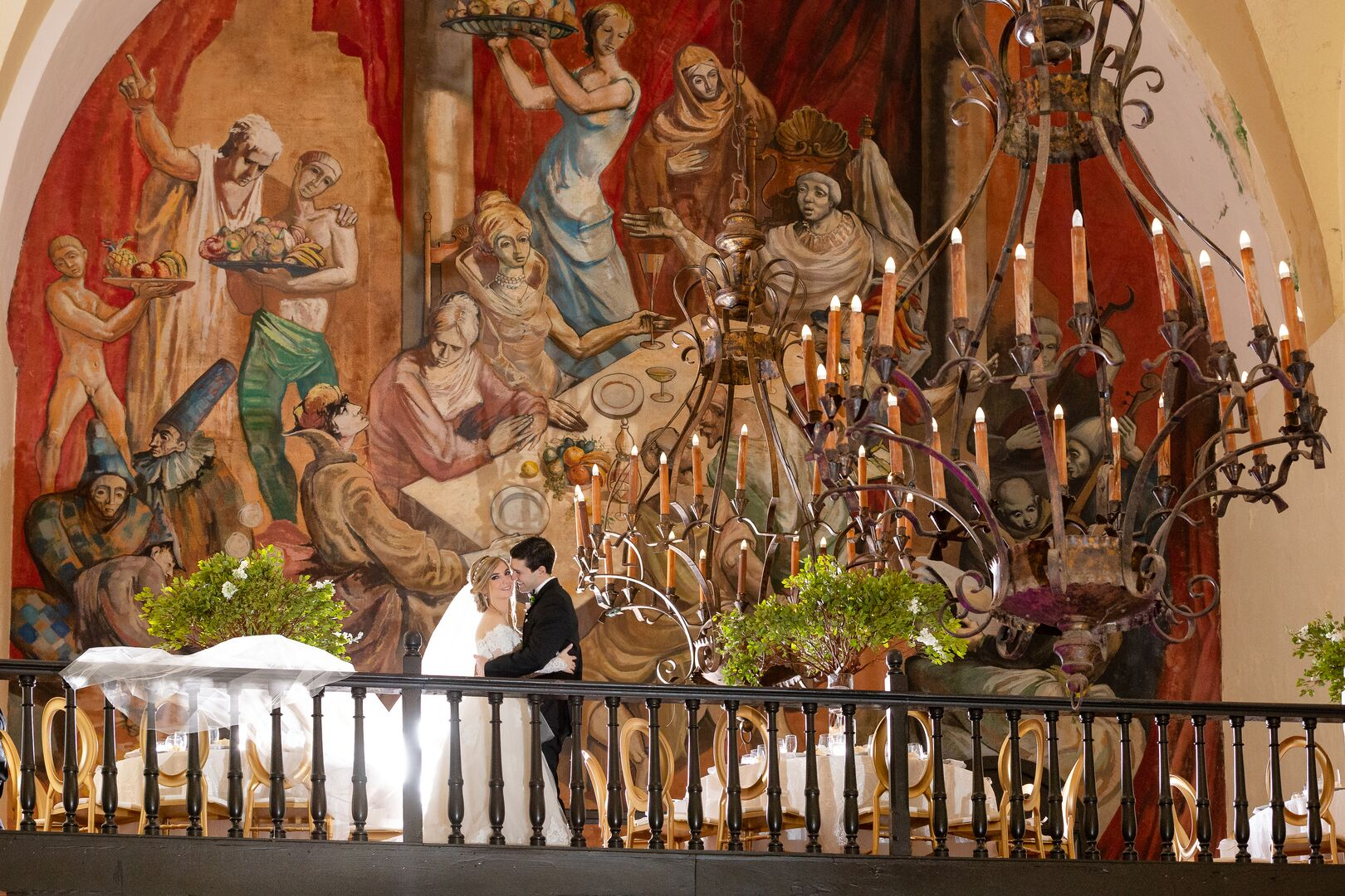 wedding couple in el convento hotel mural