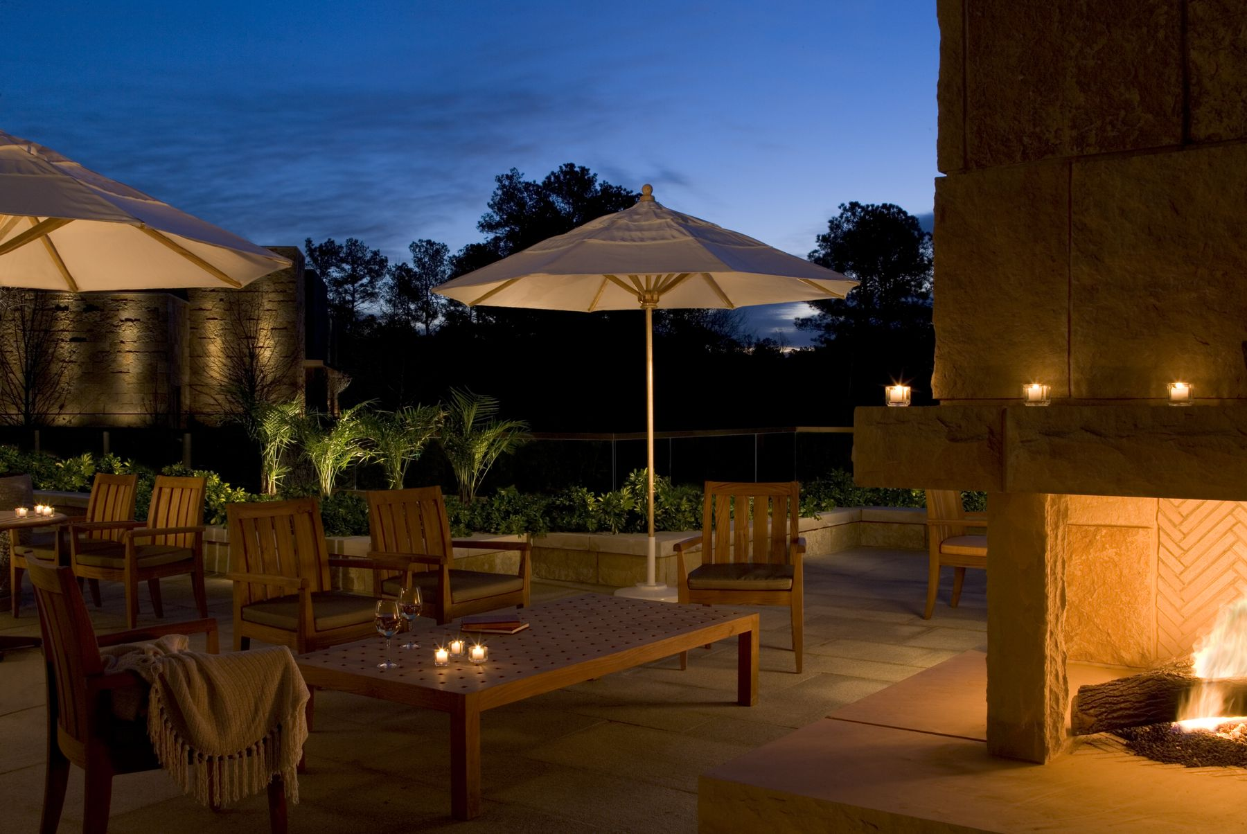outdoor terrace with umbrellas at night