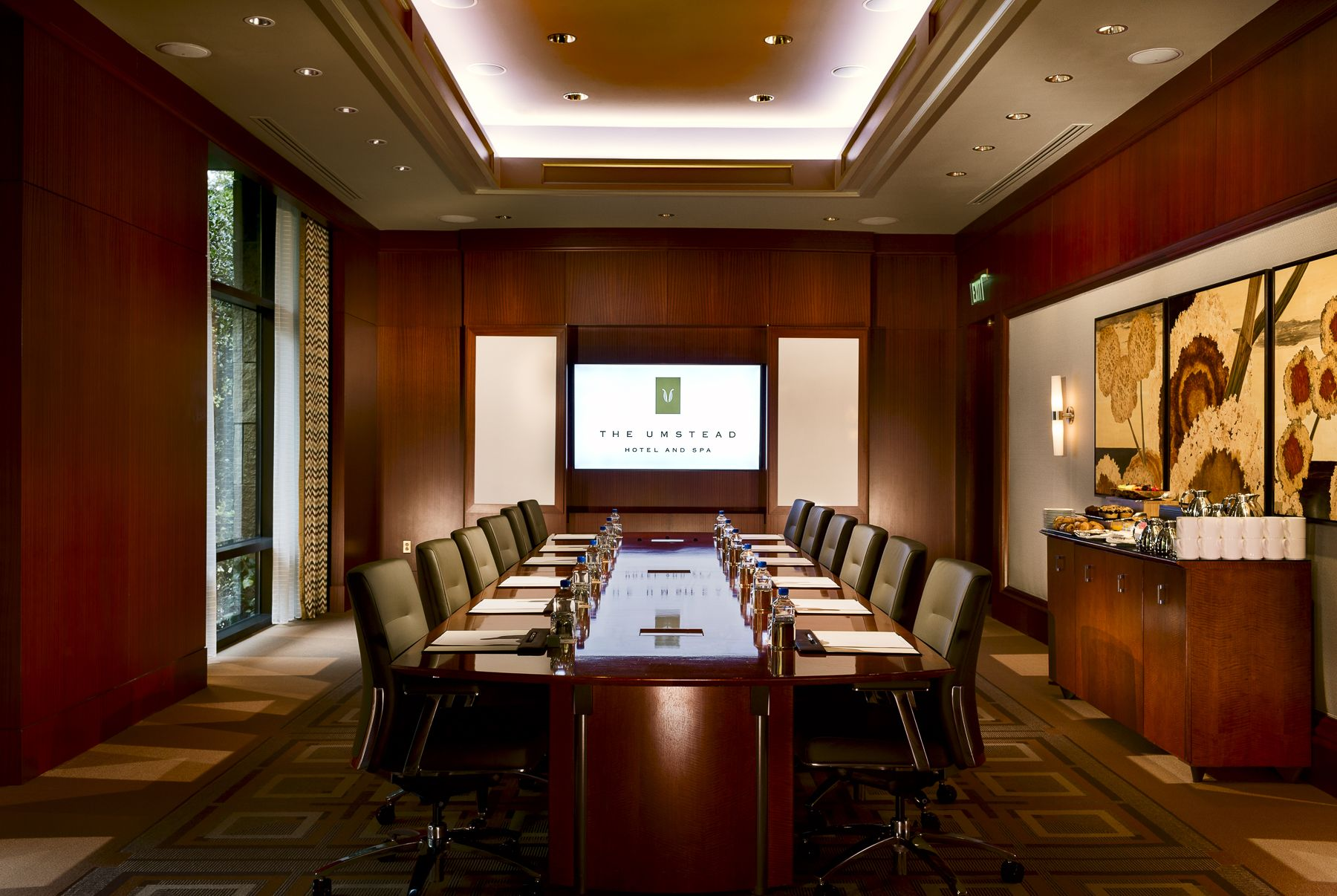 boardroom with long table and television