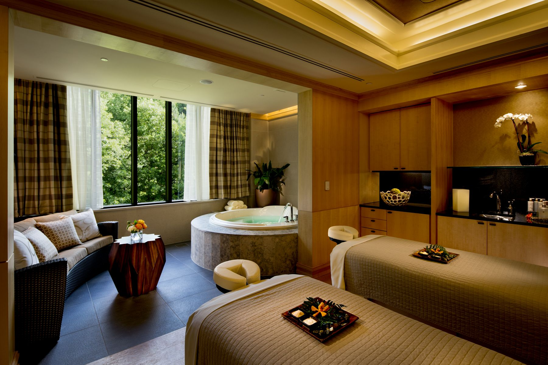 two massage tables with jacuzzi