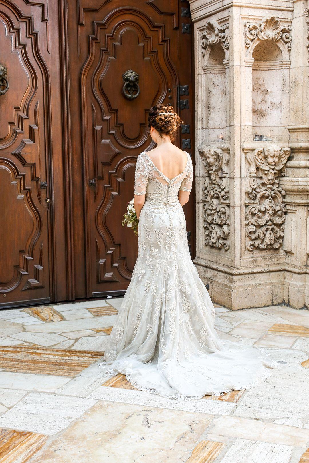 bride facing entrance of chapel