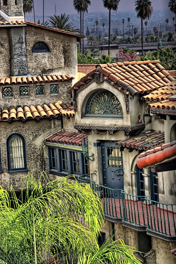 exterior of Mission Inn Hotel Riverside rooms with balcony