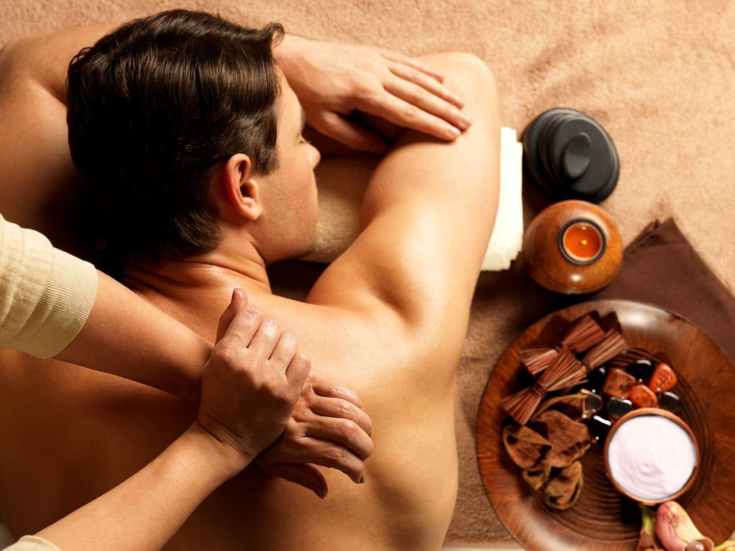 man getting back massage on table