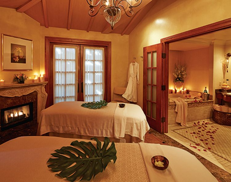 spa room with two massage tables