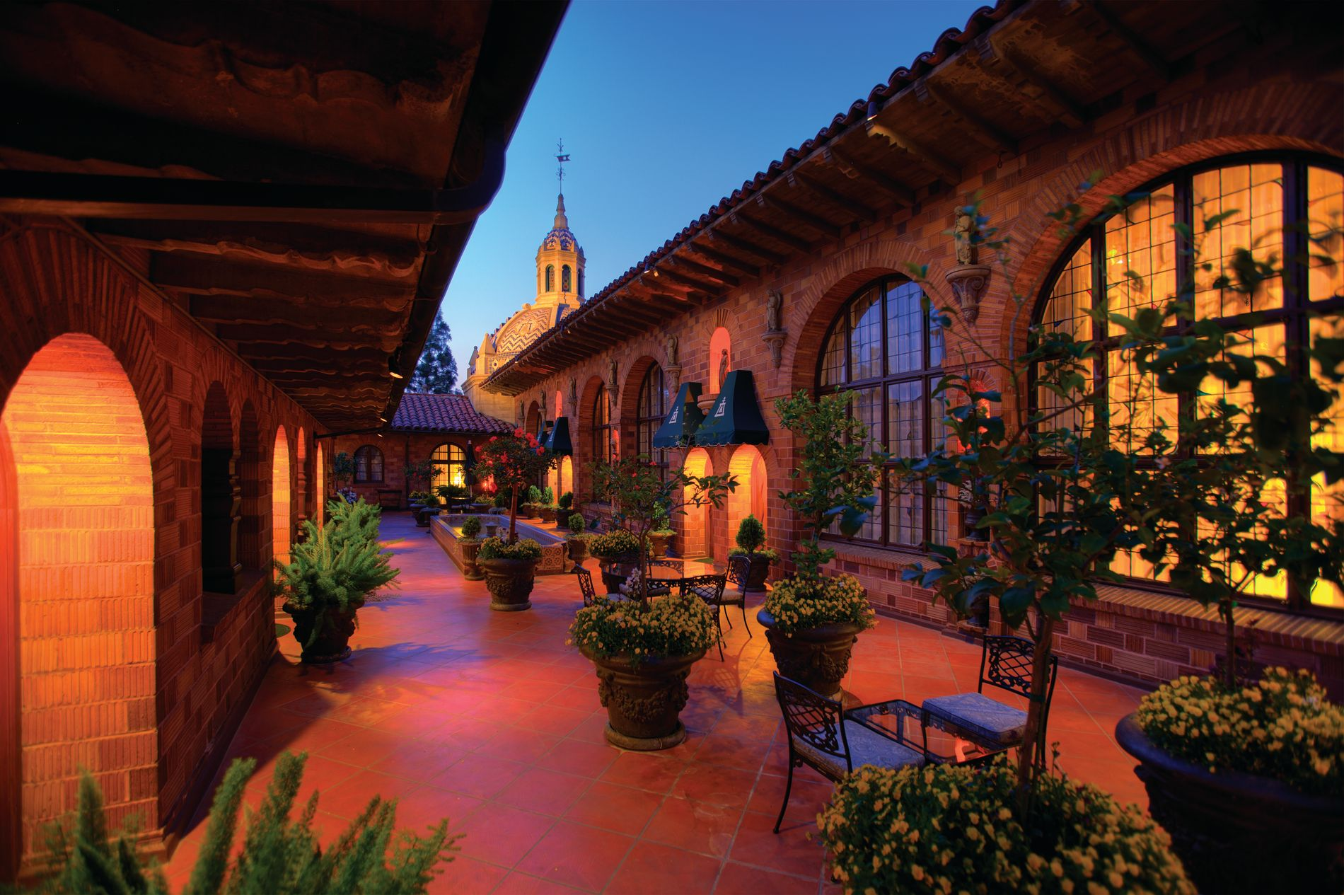 outdoor terrace at Mission Inn with tables and chairs