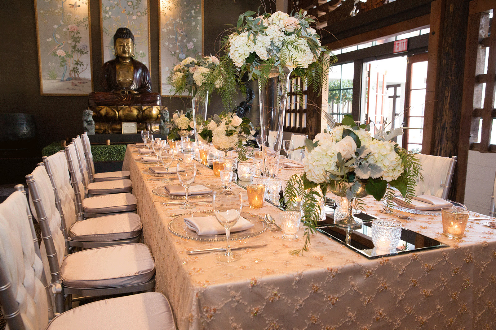 banquet room with decorated table and flowers