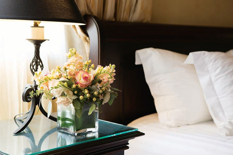 nightstand with bouquet of flowers