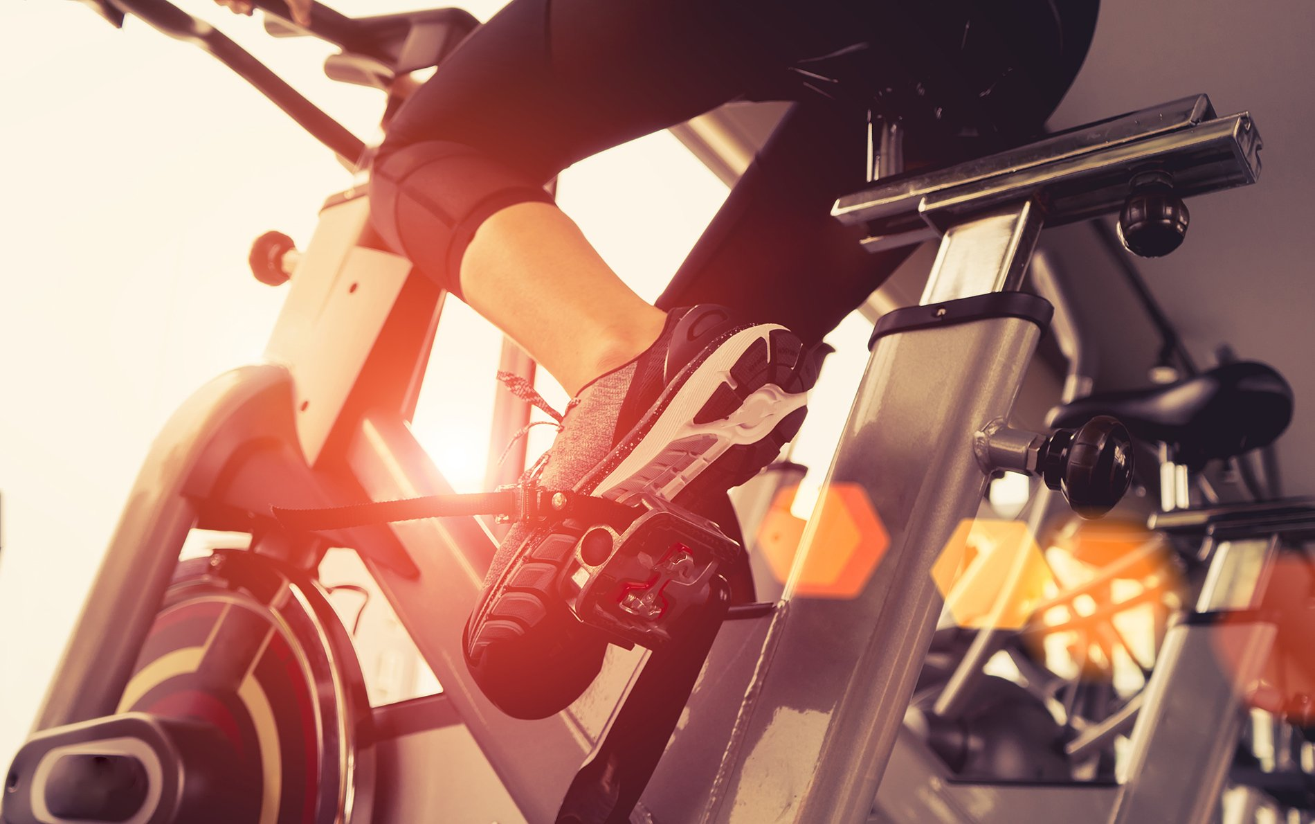 person on indoor cycle