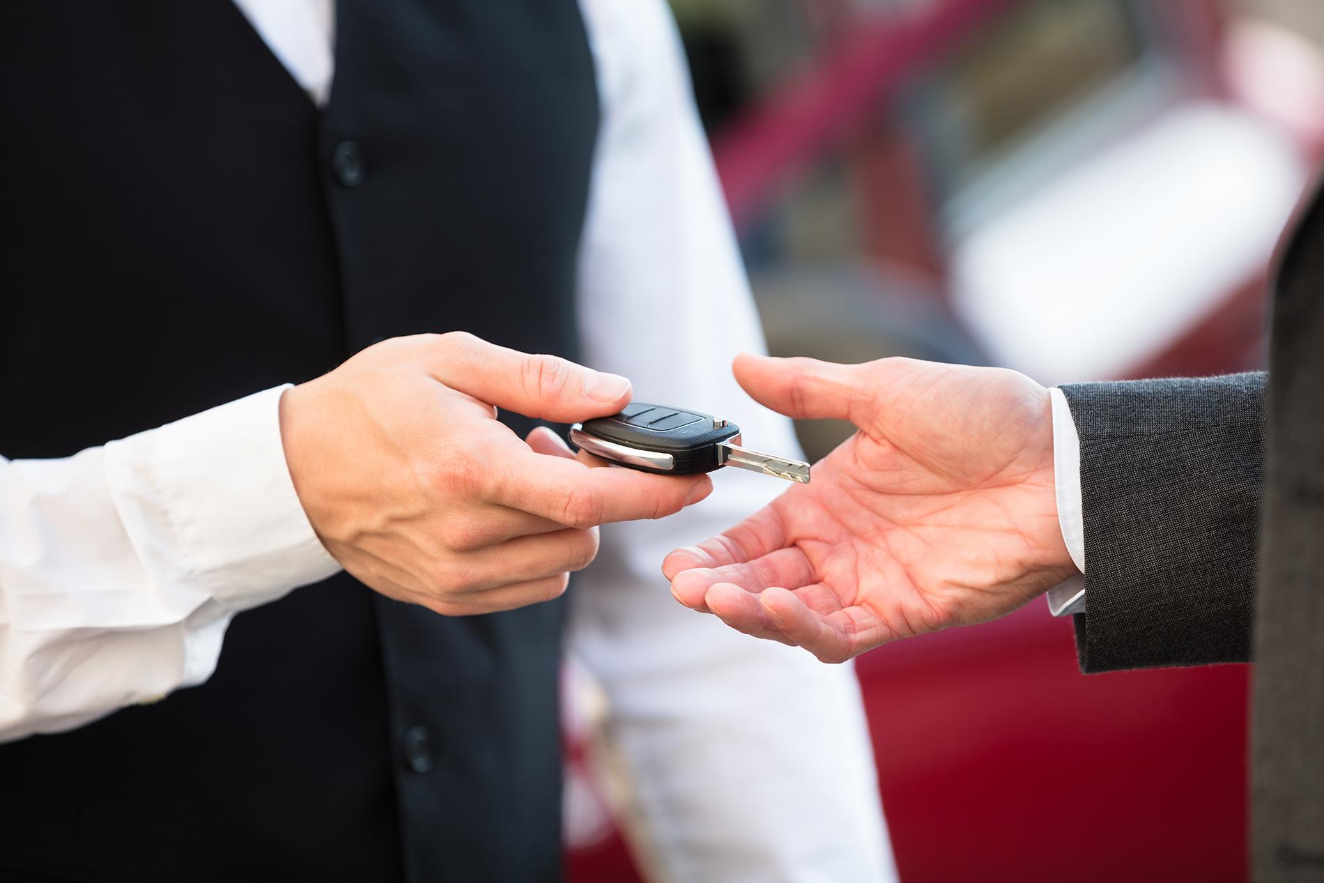 person handing car keys over