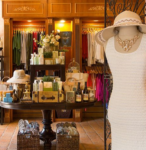 clothes and accessories in boutique store