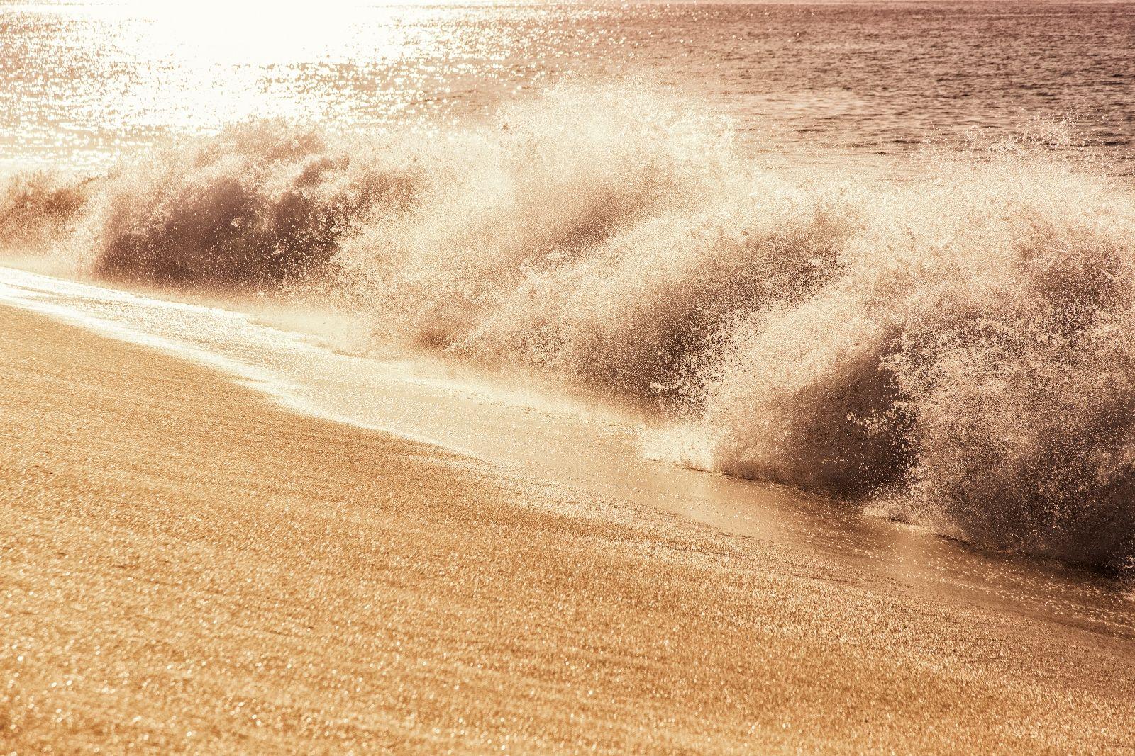 waves crash on a beach