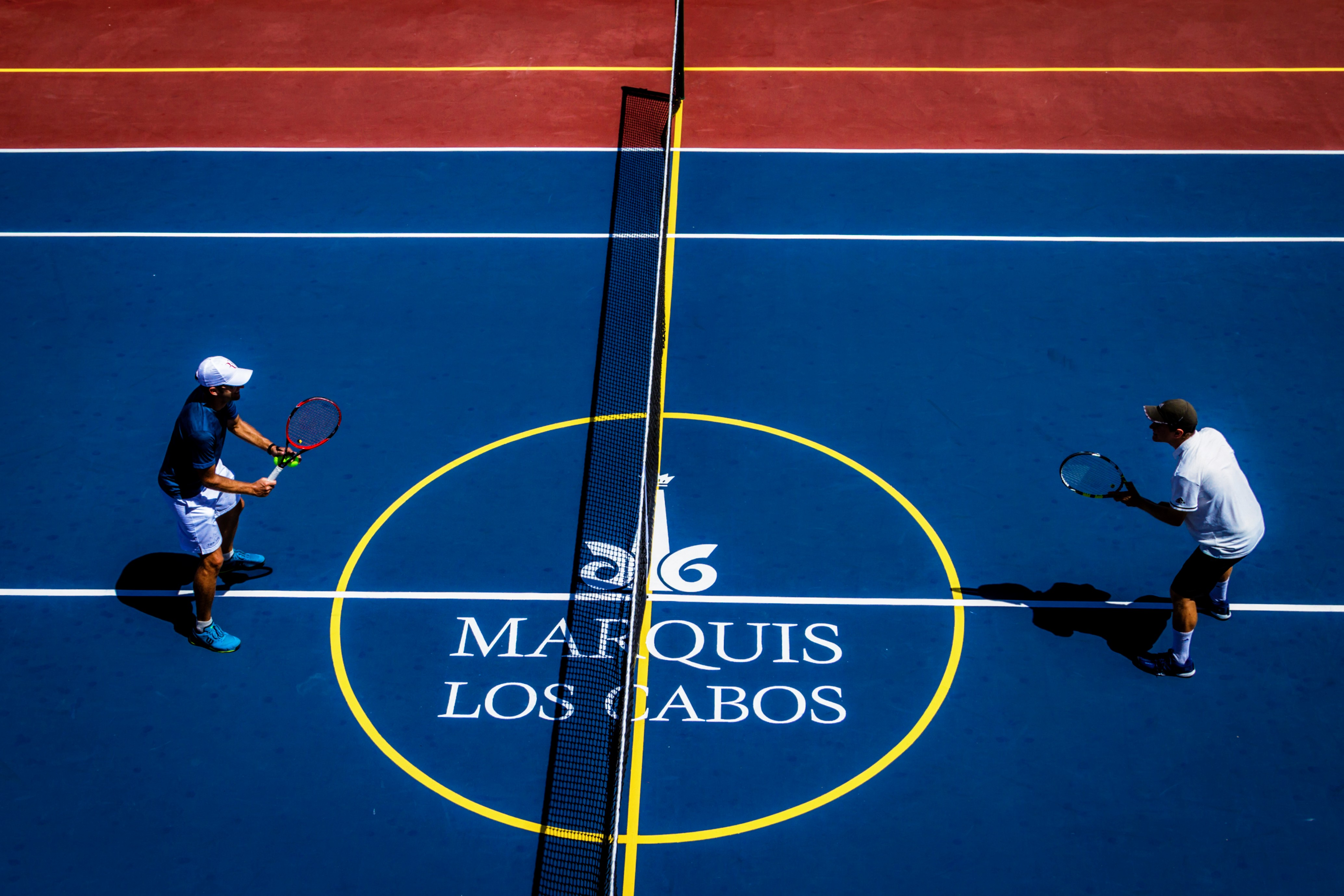 two people playing tenis