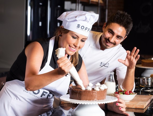Two chefs' are decorating a cake at Aoffa at WOW Airport Hotel