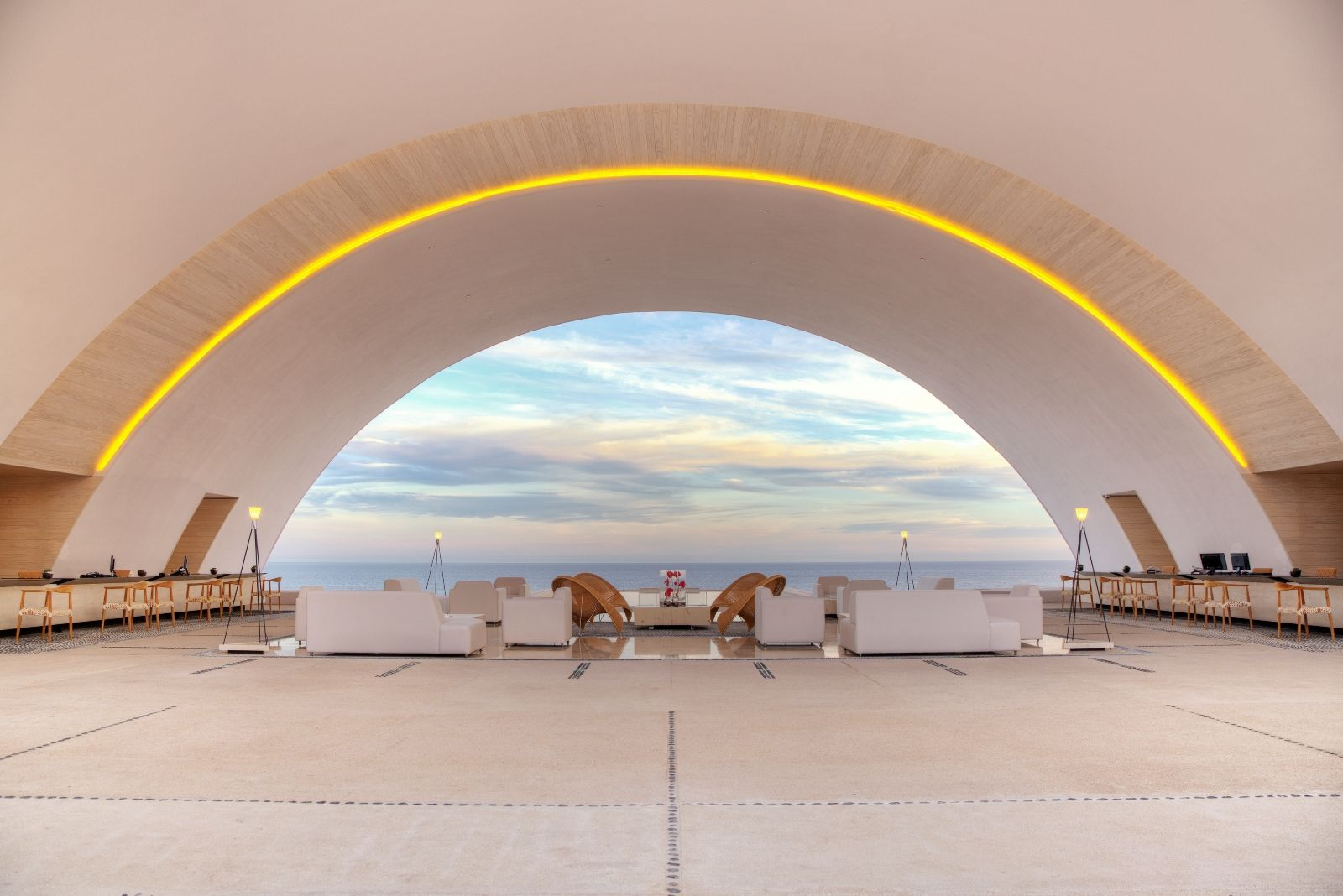 a beautiful arched ceiling in a resort lobby
