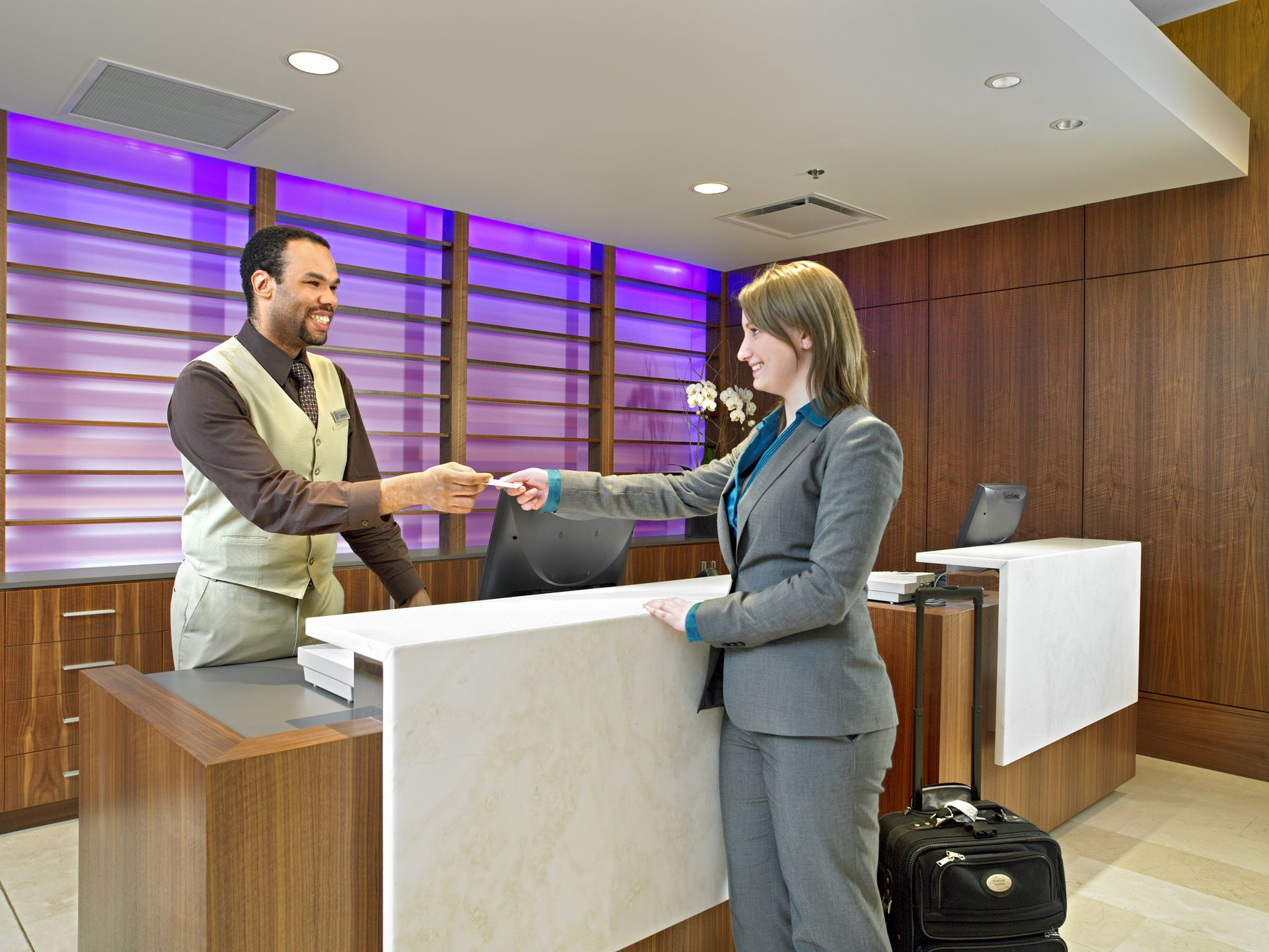 Woman checking into hotel