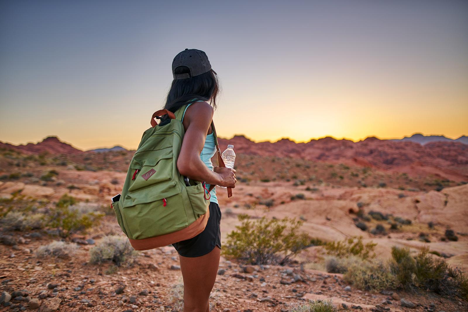 Woman backpacking in desert