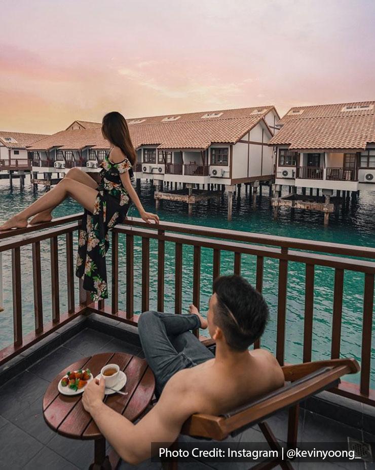 couple overwater villa water chalet lexis port dickson