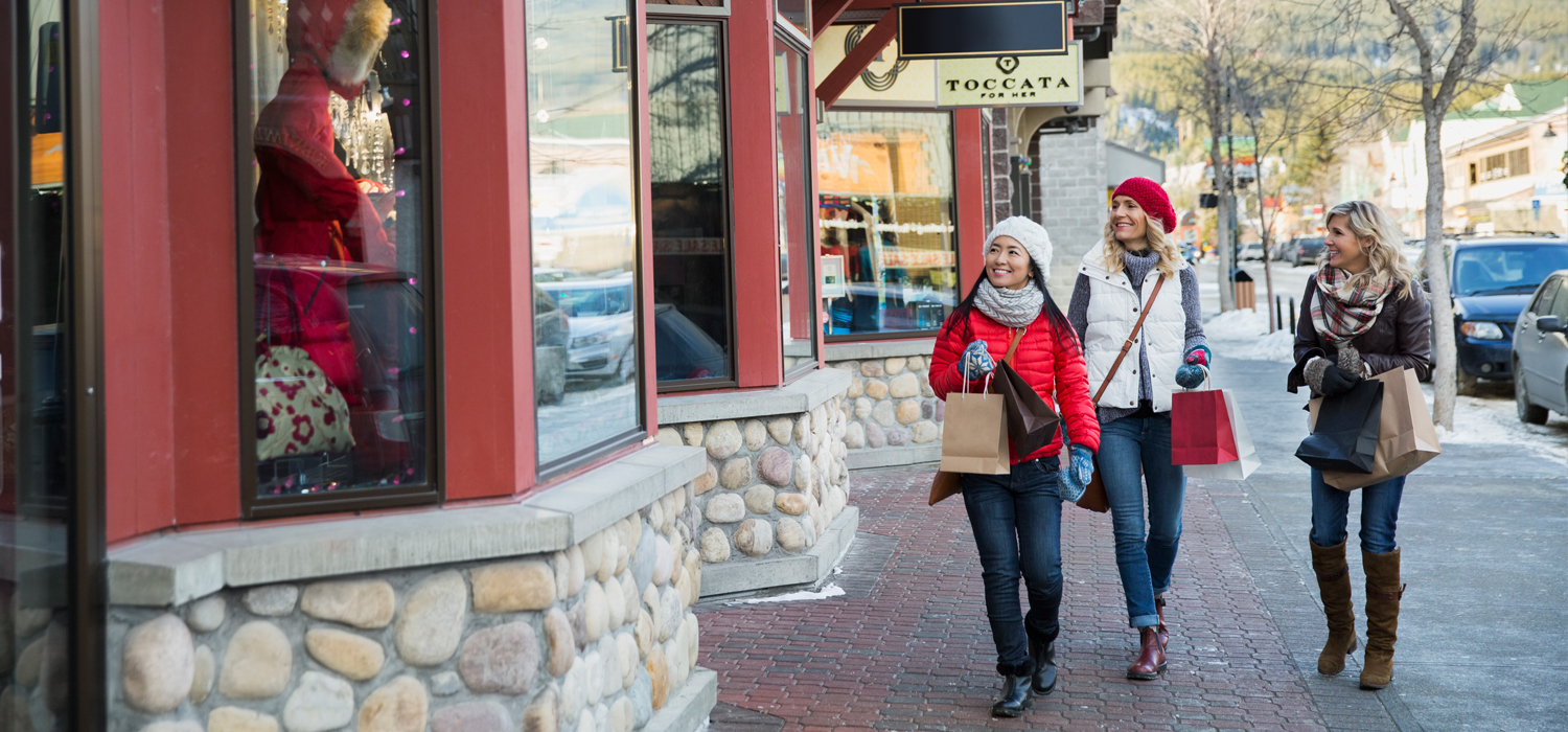 three women shopping on canmore main street