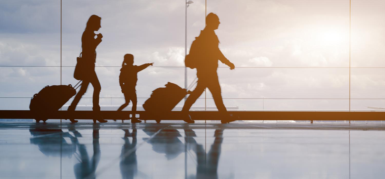 shadows of a family walking through an airport