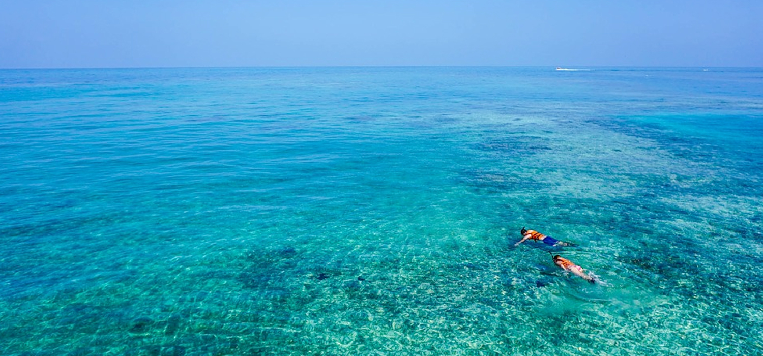 Snorkeling in bright blue water