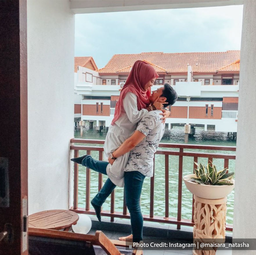 romantic couple enjoying short getaway at beach resort malaysia