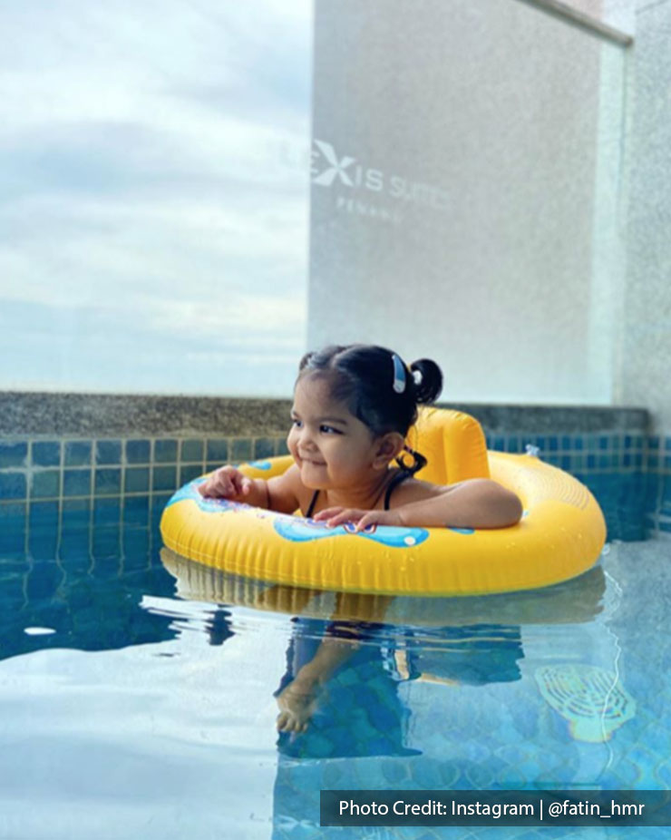 Baby swimming in a private room pool of Lexis Suites Penang