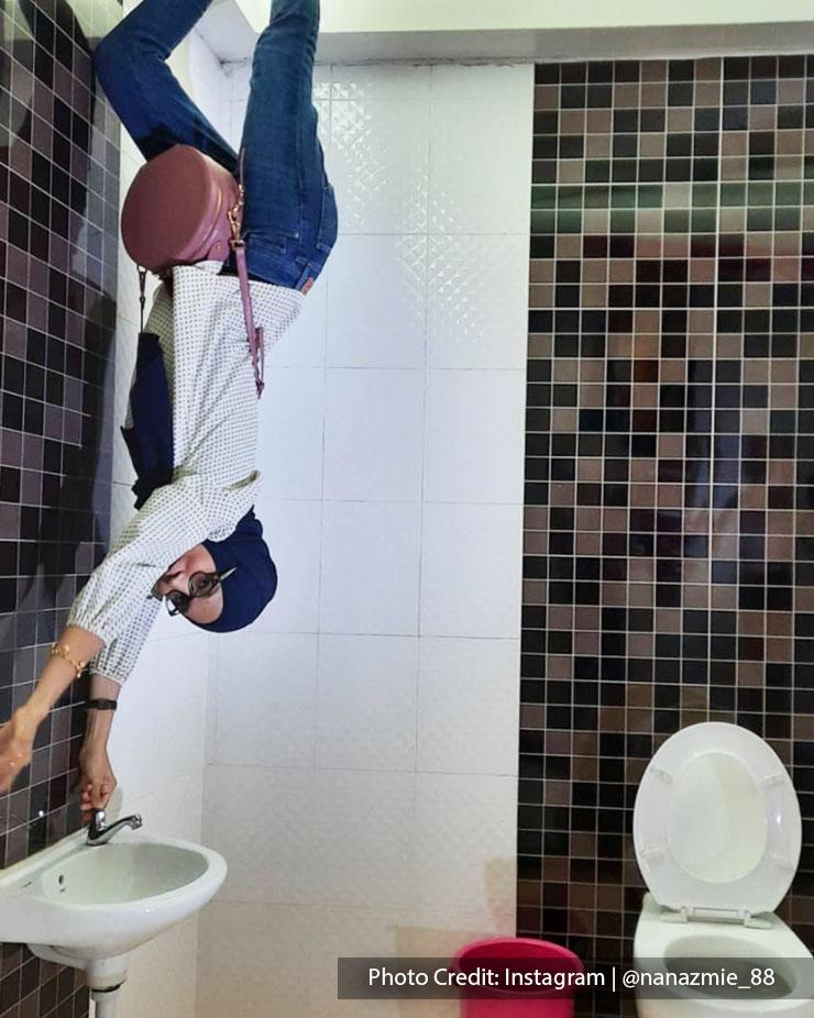 woman upside down house port dickson