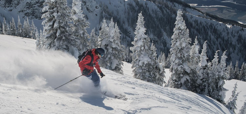 skier going down steep terrain at Revelstoke Mountain Resort