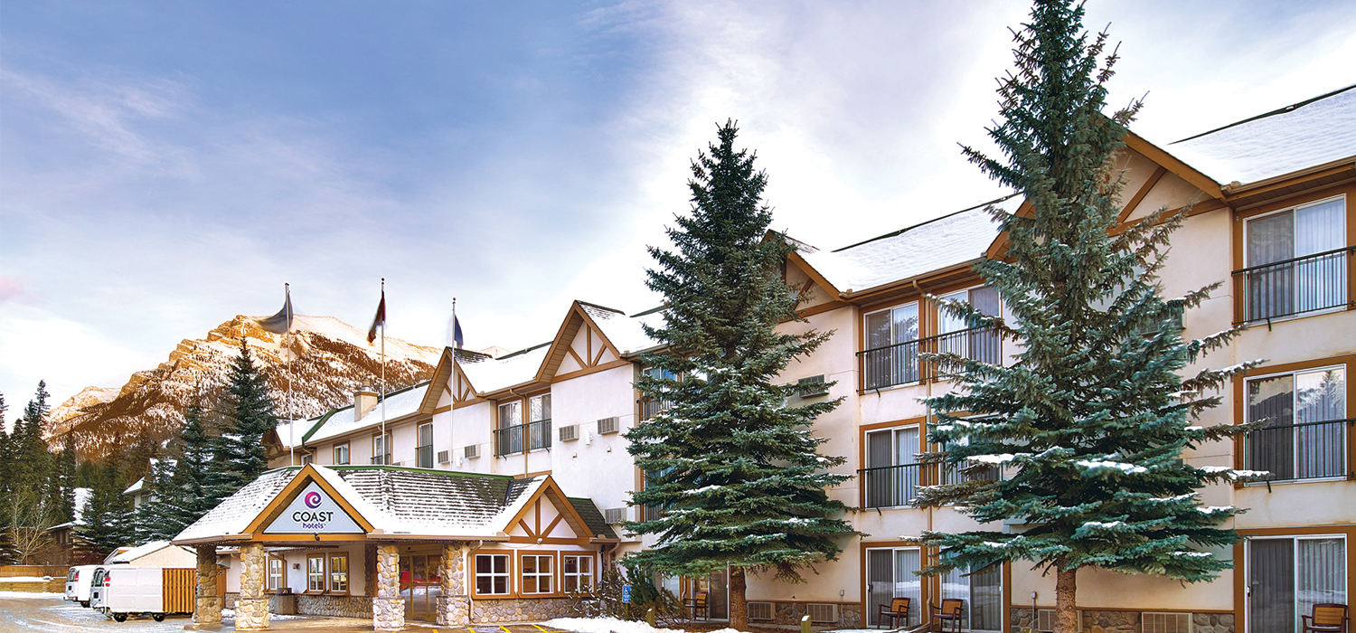 exterior of Coast Canmore Hotel in the snow