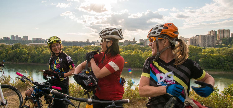 women riding through the edmonton river valley