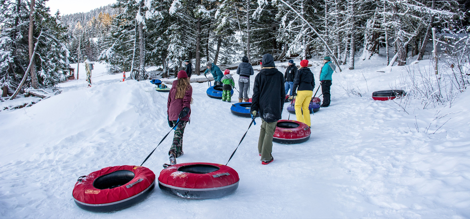tubers lined up for snow tubing in Kamloops