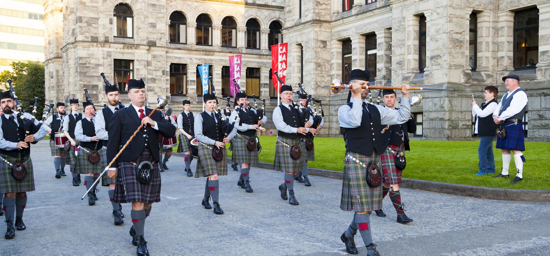 Victoria Day Highland Games men marching in tartan kilts
