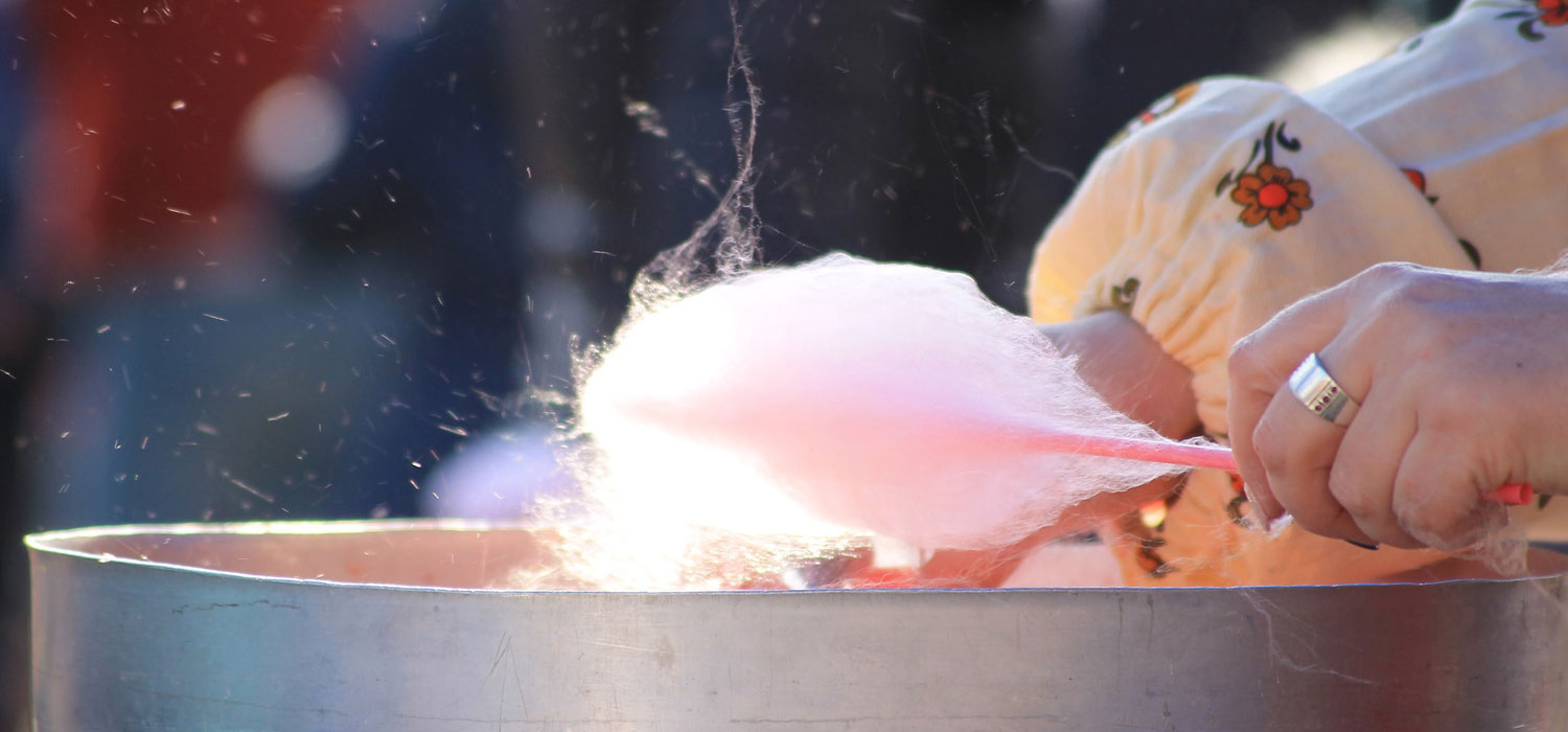 person spinning cotton candy