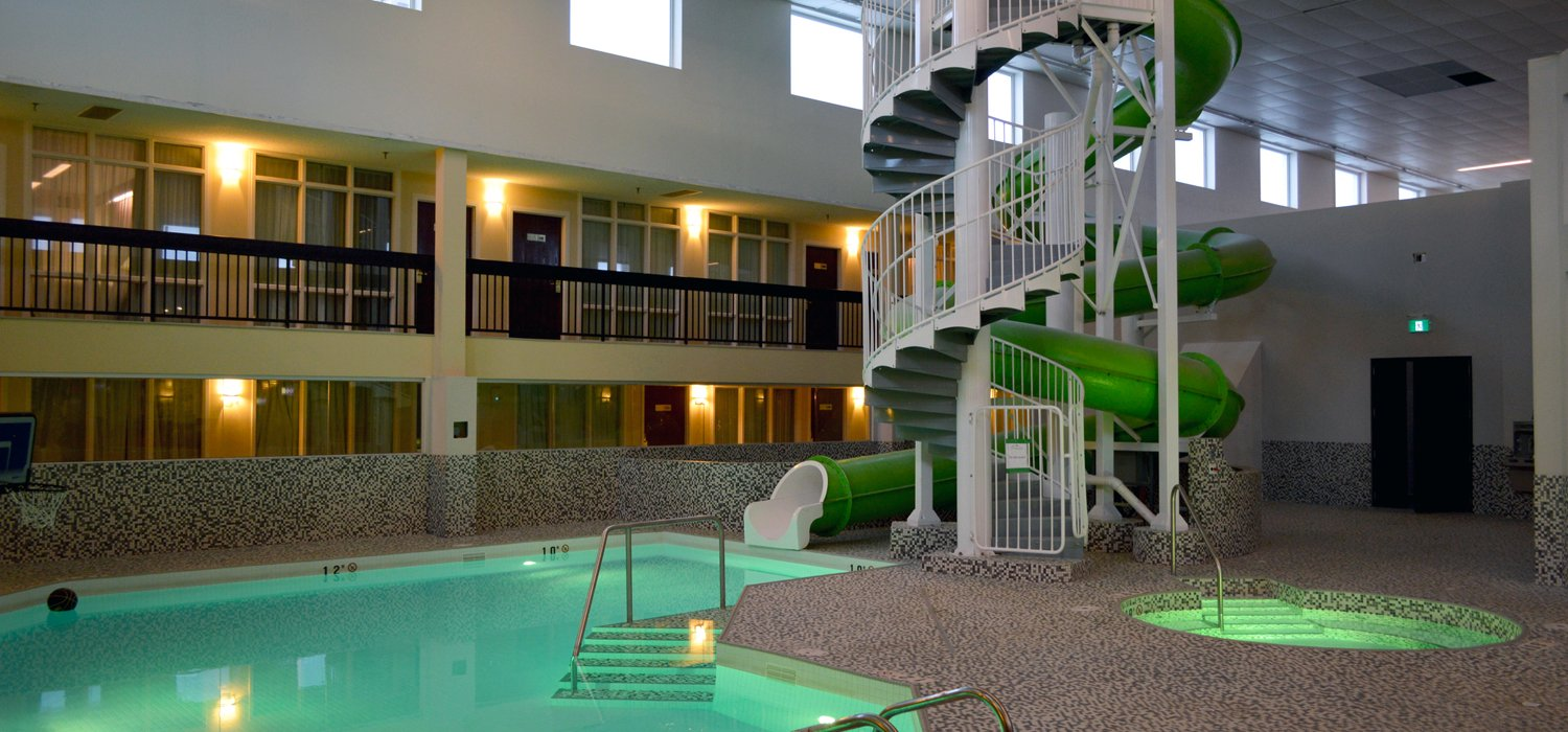 Coast Nisku indoor pool and hot tub with water slide