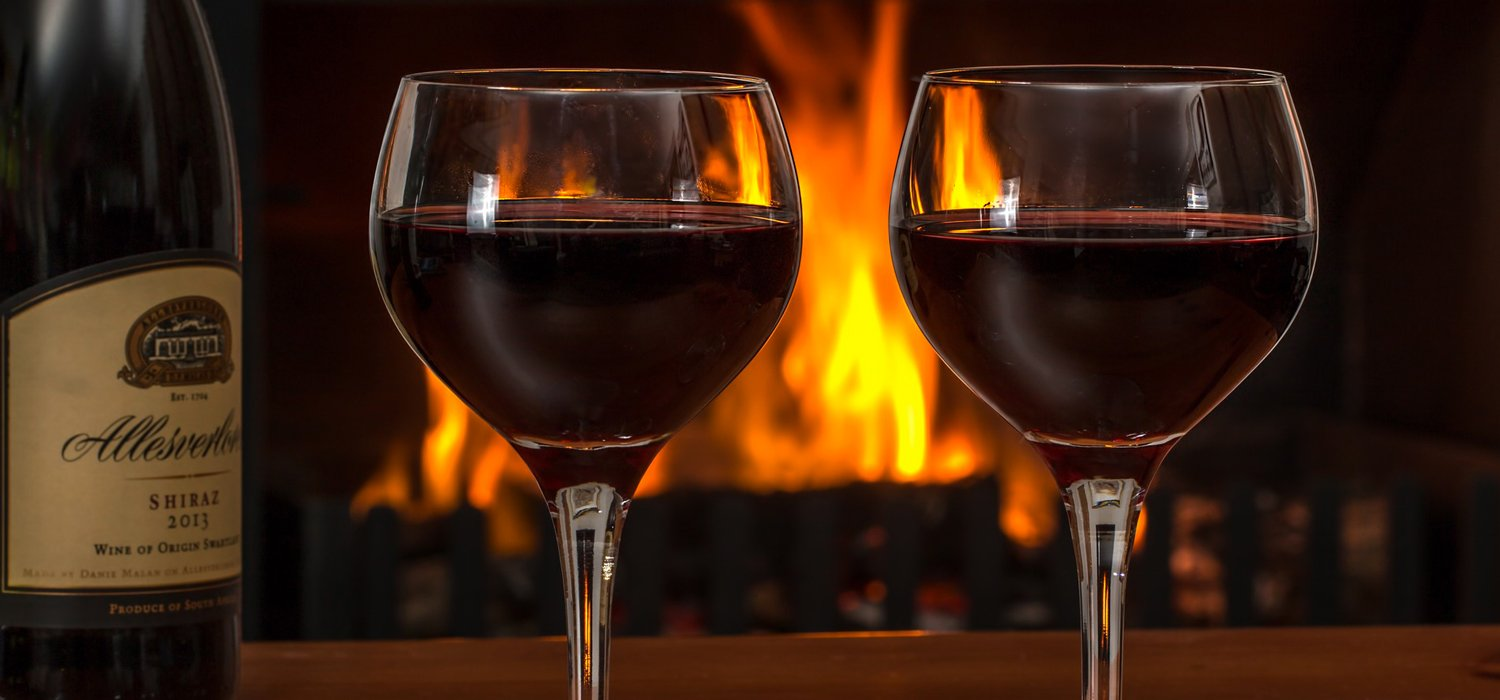 wine glasses in front of fireplace