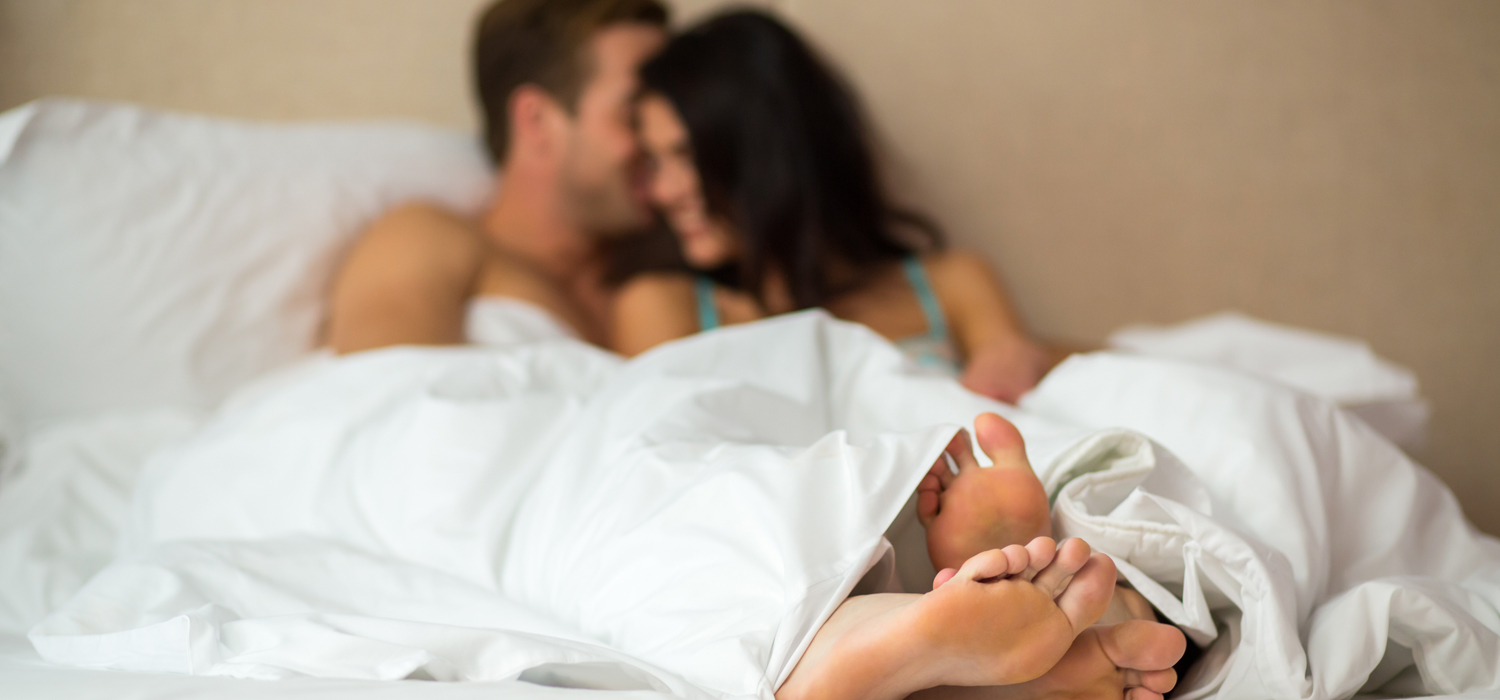 couple lounging in bed together