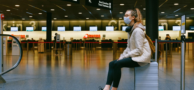 masked traveler at airport