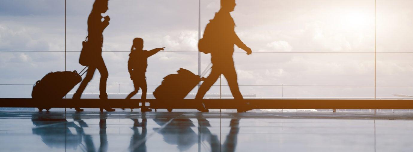 Shadows of family walking through an airport