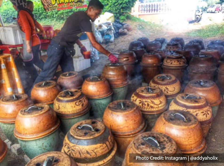 Malaysia port dickson local food man baking ayam bakar pasu side view