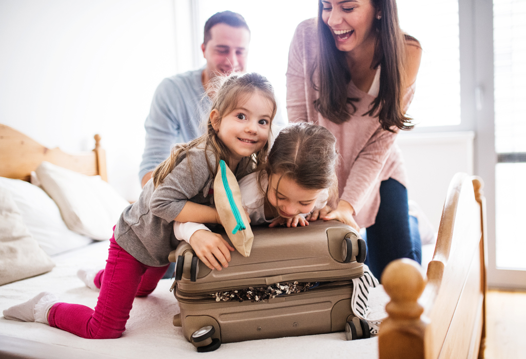 family closing suitcase together