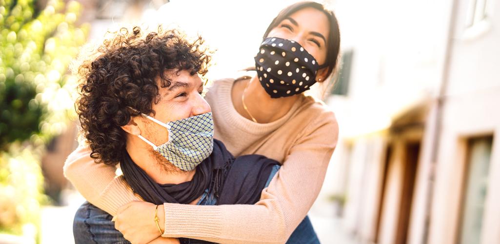 masked couple happy outside