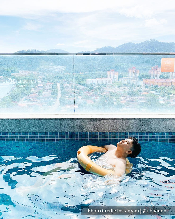 A man chilling in the swimming pool at Lexis Suites Penang