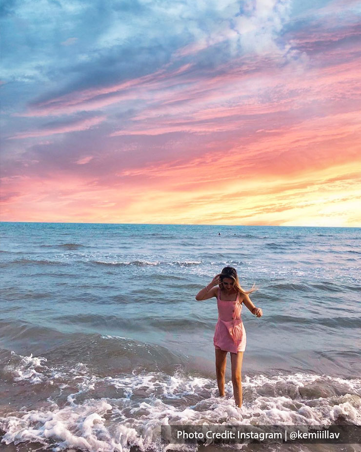 beautiful view of beach with vibrant sky and waves