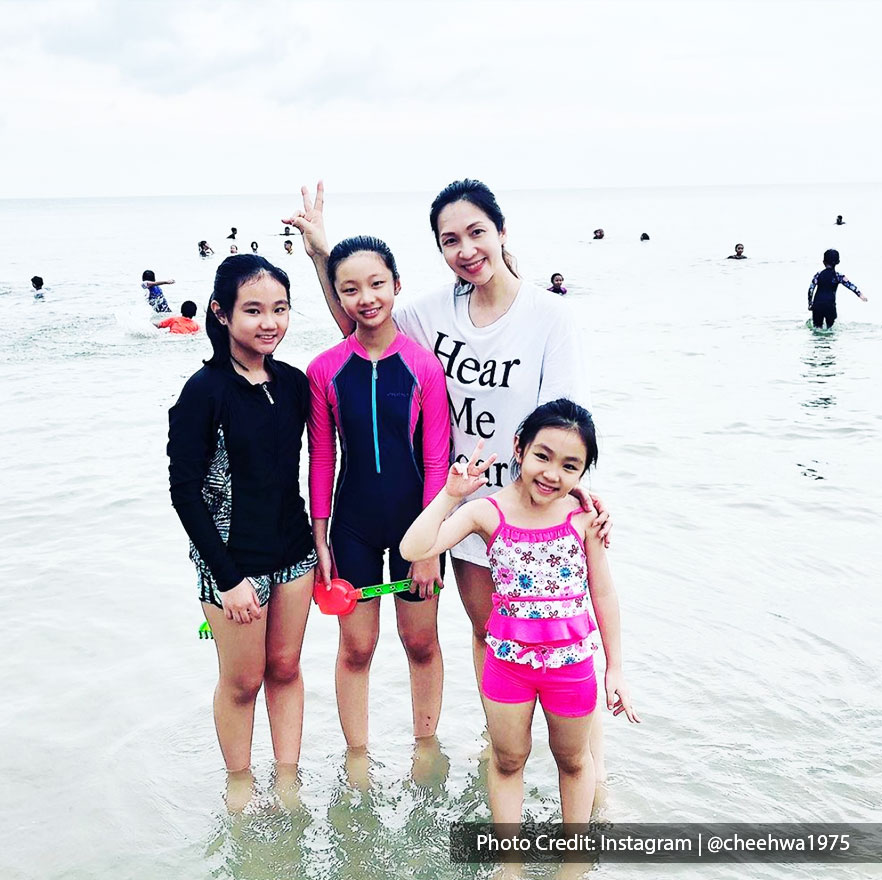family bonding at beach in Port Dickson