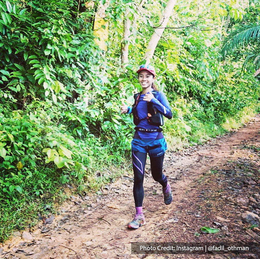 girl jogging on forest trail
