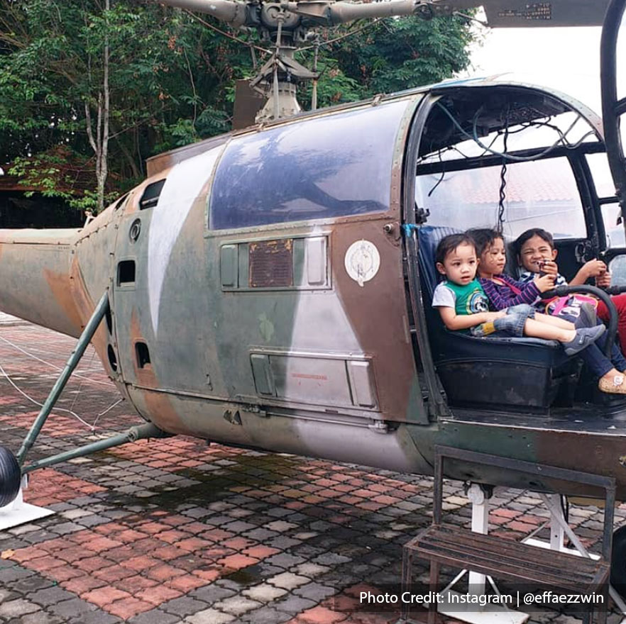 Photograph of tourists in old war helicopter