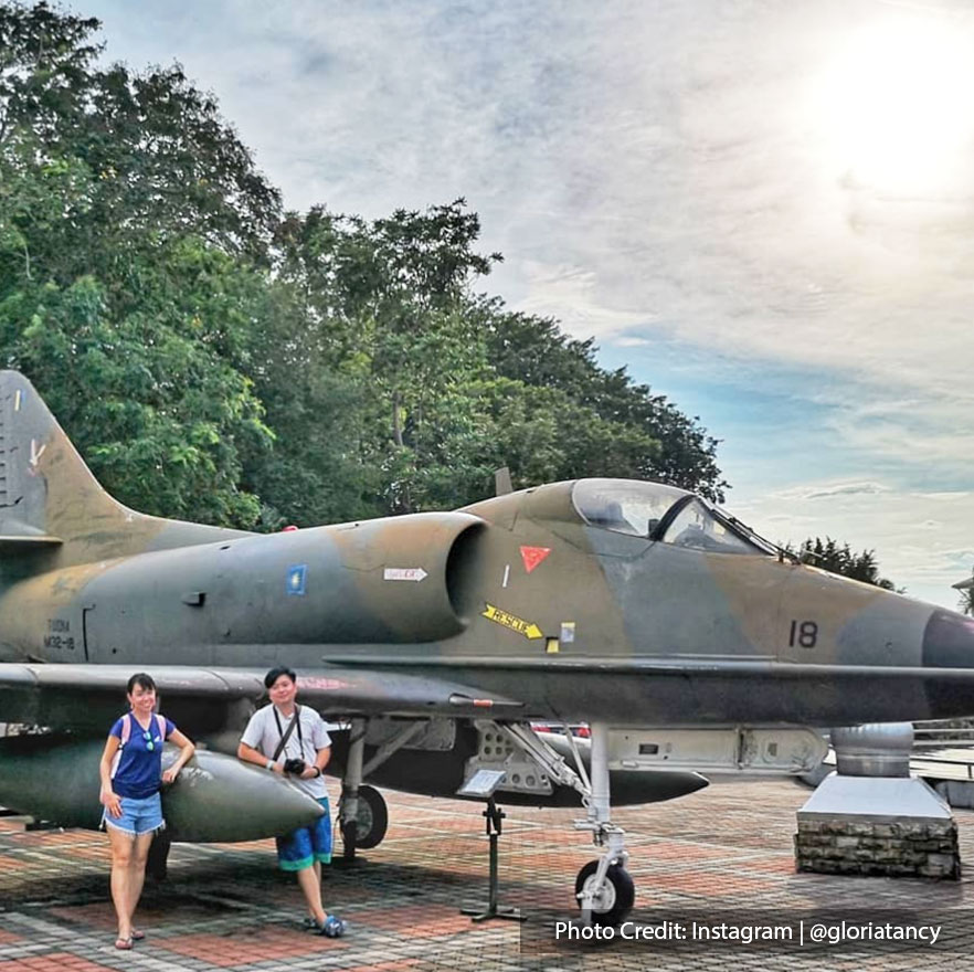 Tourist with fighter jets in army museum